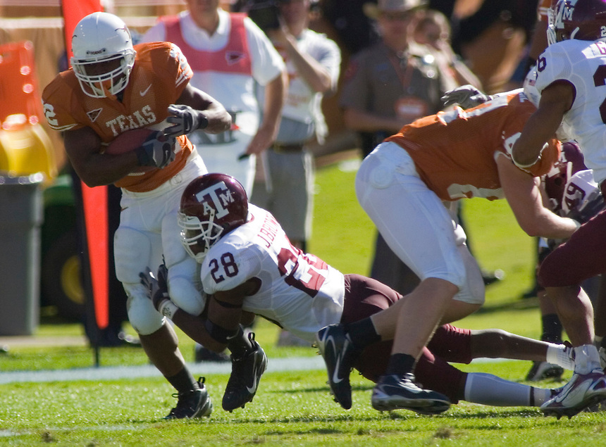 24 November 2006: Texas back Selvin Young (#22) tries to dodge a tackle by Aggie defender Japhus Brown (#28) during the Longhorns 12-7 loss to the Texas A&M University Aggies at the Darrell K Royal Memorial Field in Austin, TX.