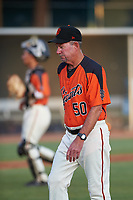 AZL Giants Orange pitching coach Mike Couchee (50) walks toward the dugout after a mound visit during an Arizona League game against the AZL Mariners on July 18, 2019 at the Giants Baseball Complex in Scottsdale, Arizona. The AZL Giants Orange defeated the AZL Mariners 7-4. (Zachary Lucy/Four Seam Images)
