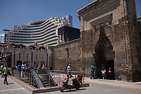 Kayseri, Turkey: where old and new are juxtaposed. The Hilton hotel looms over the 13th century Sahabiye madrasah. Escalators to the metro station are in the foreground