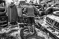 Snow,  Ice, tires and burned wreckages  characterize the forefront of the protest