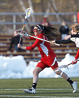 Boston University attacker Elizabeth Morse (5) takes a shot from a free position..Boston College (white) defeated Boston University (red), 12-9, on the Newton Campus Lacrosse Field at Boston College, on March 20, 2013.