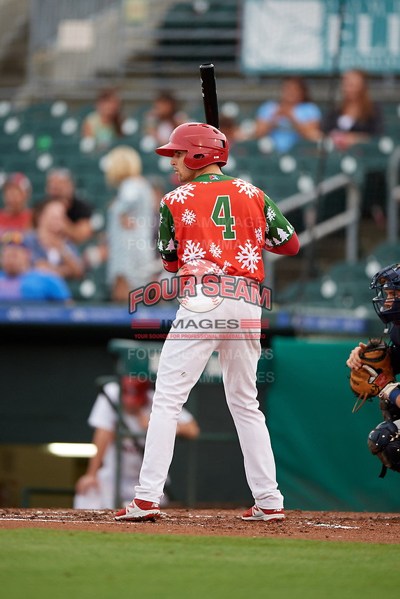 """Palm Beach Cardinals right fielder Thomas Spitz (8) at bat during a game against the Charlotte Stone Crabs on July 22, 2017 at Roger Dean Stadium in Palm Beach, Florida.  The Cardinals wore special """"Ugly Sweater"""" jerseys for Christmas in July.  Charlotte defeated Palm Beach 5-2.  (Mike Janes/Four Seam Images)"""