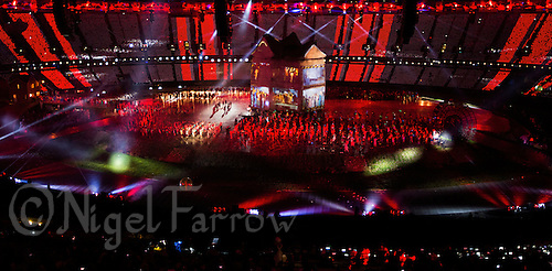 """27 JUL 2012 - LONDON, GBR - Performers dance around a giant house onto which scenes from British TV, films and music videos were projected during the """"Frankie and June say...thanks Tim"""" section of the Opening Ceremony of the London 2012 Olympic Games in the Olympic Stadium in the Olympic Park, Stratford, London, Great Britain .(PHOTO (C) 2012 NIGEL FARROW)"""