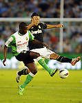 SANTANDER - SEPTEMBER 21:  Mesut Ozil of Real Madrid (R) duels for the ball with Papakouli Diop of Real Racing Club during the La Liga soccer match between Real Racing Club and Real Madrid at El Sardinero Stadium on September 21, 2011 in Santander, Spain. Photo by Victor Fraile / The Power of Sport Images