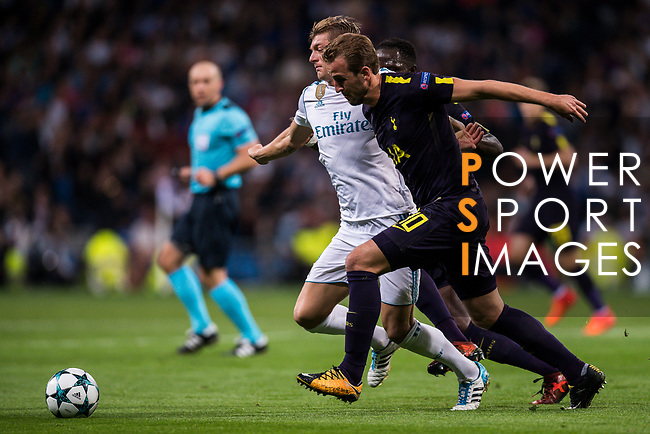 Toni Kroos of Real Madrid (L) fights for the ball with Harry Kane of Tottenham Hotspur FC (R) and Moussa Sissoko of Tottenham Hotspur FC (back) during the UEFA Champions League 2017-18 match between Real Madrid and Tottenham Hotspur FC at Estadio Santiago Bernabeu on 17 October 2017 in Madrid, Spain. Photo by Diego Gonzalez / Power Sport Images