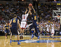 March 21st, 2013: Richard Solomon grabs the ball during final seconds of the West Coast Conference men's NCAA game against UNLV at HP Pavilion, San Jose, California. California defeated UNLV 64 - 61