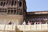 Jodhpur, India. Mehrangarh Fort; Indian visitors in bright colourful dress on a balcony