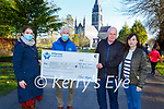 Marguerite Hickey and Tom O'Connor right presents the proceeds of the Walk with Margaret virtual walk in aid of the Pallative Care Unit Tralee in memory of Margaret O'Connor to Marie O'Connell and Pat Doolin in Killarney on Thursday