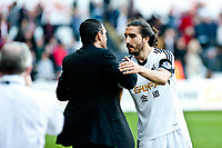 Saturday 19 October 2013 Pictured: Gus Poyet, Manager of Sunderland shakes hands with Chico Flores of Swansea<br /> Re: Barclays Premier League Swansea City vSunderland at the Liberty Stadium, Swansea, Wales