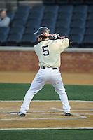 Drew Freedman (5) of the Wake Forest Demon Deacons at bat against the UConn Huskies at Wake Forest Baseball Park on March 17, 2015 in Winston-Salem, North Carolina.  The Demon Deacons defeated the Huskies 6-2.  (Brian Westerholt/Four Seam Images)