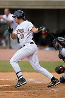 Julio Martinez #20 of the Greeneville Astros follows through on his swing versus the Danville Braves at Pioneer Park June 28, 2009 in Greeneville, Tennessee. (Photo by Brian Westerholt / Four Seam Images)