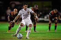 LAKE BUENA VISTA, FL - JULY 23: Cristian Pavon #10 of the LA Galaxy kicks the ball during a game between Los Angeles Galaxy and Houston Dynamo at ESPN Wide World of Sports on July 23, 2020 in Lake Buena Vista, Florida.