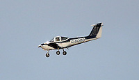 Pictured: G-BOMO light aircraft approaches Swansea AIrport Wednesday 23 December 2015<br /> Re: Swansea City FC training ahead of their West Bromwich Albion game, Fairwood, near Swansea, Wales, UK