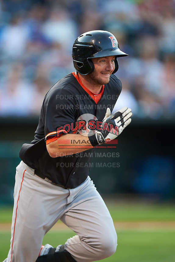Fresno Grizzles outfielder Robbie Grossman (15) runs to first during a game against the Oklahoma City Dodgers on June 1, 2015 at Chickasaw Bricktown Ballpark in Oklahoma City, Oklahoma.  Fresno defeated Oklahoma City 14-1.  (Mike Janes/Four Seam Images)