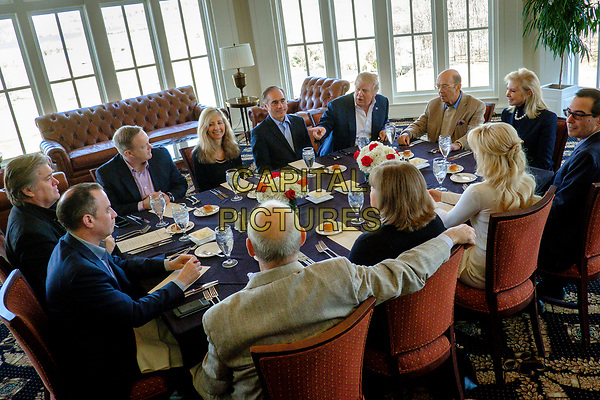 United States President Donald Trump has a working lunch with staff and cabinet members and significant others at his golf course, Trump National Golf Club in Potomac Falls, Virginia, U.S., on Saturday, March 11, 2017.  Seated around the table from left: Assistant to the President and White House Chief Strategist Steve Bannon; White House Chief of Staff Reince Priebus; White House Press Secretary Sean Spicer; Merle Bari Shulkin; US Secretary of Veterans Affairs David Shulkin; President Trump; US Secretary of Commerce Wilbur Ross; Hilary Geary Ross; US Secretary of the Treasury Steven Mnuchin; Louise Linton; Karen Hernest Kelly; and US Secretary of Homeland Security John F. Kelly. <br /> CAP/MPI/CNP/RS<br /> ©RS/CNP/MPI/Capital Pictures
