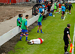 Salford City 2 FC United of Manchester 1, 15/07/2017. Moor Lane, Pre Season Friendly. The FCUM subs are unconcerned as a Salford player lies injured. Salford City v FC United of Manchester in a pre season friendly at Moor Lane Salford. Photo by Paul Thompson.
