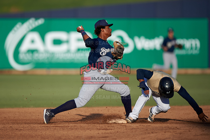 AZL Brewers Blue second baseman Orveo Saint (30) throws to first base to complete a double play during an Arizona League game against the AZL Brewers Gold on July 13, 2019 at American Family Fields of Phoenix in Phoenix, Arizona. The AZL Brewers Blue defeated the AZL Brewers Gold 6-0. (Zachary Lucy/Four Seam Images)