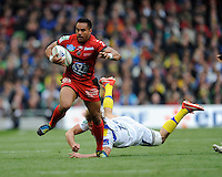 Rudi Wulf of RC Toulon charges through the tackle of Aurelien Rougerie of ASM Clermont Auvergne during the Heineken Cup Final between ASM Clermont Auvergne and RC Toulon at the Aviva Stadium, Dublin on Saturday 18th May 2013 (Photo by Rob Munro)
