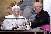 Monsignor Alfred Xuereb secretary to Pope Benedict XVI blesses pilgrims during his Angelus prayer ahead of a mass to mark the Assumption Day, honoring the Virgin Mary in the church of his summer residence in Castel Gandolfo, in the outskirts of Rome, on August 15, 2012