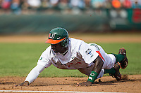 Miami Hurricanes outfielder Jacob Heyward (24) dives back to first base during the NCAA College baseball World Series against the Arkansas Razorbacks  on June 15, 2015 at TD Ameritrade Park in Omaha, Nebraska. Miami beat Arkansas 4-3. (Andrew Woolley/Four Seam Images)