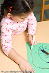 Educaton preschool  3-4 year olds art activity girl drawing with marker vertical
