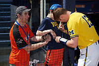 Michigan Wolverines designated hitter Dominic Clementi (13) signs autographs before a game against Army West Point on February 17, 2018 at Tradition Field in St. Lucie, Florida.  Army defeated Michigan 4-3.  (Mike Janes/Four Seam Images)