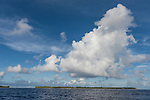 Rangiroa Atoll, Tuamotu Archipelago, French Polynesia; a view of Tiputa Pass in early morning sunlight from the ocean side of Rangiroa Atoll