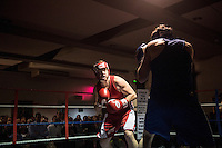 Danny Williams (left) fights Lee Klinger at a white collar boxing event at the London Irish Centre where the 'Carpe Diem' boxing event is taking place. <br /> <br /> 'White-collar boxing' is a growing phenomenon amongst well paid office workers and professionals and has seen particular growth in financial centres like London, Hong Kong and Shanghai. It started at a blue-collar gym in Brooklyn in 1988 with a bout between an attorney and an academic and has since spread all over the world. The sport is not regulated by any professional body in the United Kingdom and is therefore potentially dangerous, as was proven by the death of a 32-year-old white-collar boxer at an event in Nottingham in June 2014. The London Irish Centre, amongst other venues, hosts a regular bout called 'Carpe Diem'. At most bouts participants fight to win. Once boxers have completed a few bouts they can participate in 'title fights' where they compete for a replica 'belt'.