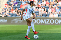 BRIDGEVIEW, IL - JULY 18: Alana Cook #4 of the OL Reign plays the ball during a game between OL Reign and Chicago Red Stars at SeatGeek Stadium on July 18, 2021 in Bridgeview, Illinois.