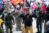 Trump supporters gather outside the Capitol, Wednesday, Jan. 6, 2021, in Washington. As Congress prepares to affirm President-elect Joe Biden's victory, thousands of people have gathered to show their support for President Donald Trump and his claims of election fraud. (AP Photo/Manuel Balce Ceneta)