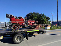 BNPS.co.uk (01202 558833)<br /> Pic: Beaulieu/BNPS<br /> <br /> Pictured: Mr Toad's car being transported.<br /> <br /> Mr Toad's car from Wind in the Willows has gone on display after a painstaking restoration following years of neglect.<br /> <br /> The vehicle was made for the 1996 film adaptation of Kenneth Grahame's classic 1908 children's book starring Terry Jones as the obsessive amphibian.<br /> <br /> The car, which appears to be from the Edwardian era, was actually built in 1995 at Shepperton Studios for the film.<br /> <br /> Following the film's release, it was transported to America, where it spent many years hanging from the ceiling of a Florida restaurant.<br /> <br /> It was brought back to Britain last year in a dilapidated state and has been restored at the National Motor Museum workshop in Beaulieu, Hants, where visitors can see it driven around the grounds.