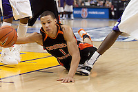 Jared Cunningham falls on the dribbles. The Washington Huskies defeated the Oregon State Beavers 59-52 during the Pac-10 Tournament at the Staples Center in Los Angeles, California on March 11th, 2010.