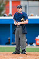 Home plate umpire A.J. Jordan during a stoppage in play at Burlington Athletic Park August 4, 2009 in Burlington, North Carolina. (Photo by Brian Westerholt / Four Seam Images)