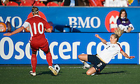 25 May 09:  USA National defender Heather Mitts #2  and Canadian National defender Martina Franko #10 in action in an International Friendly soccer game between the US Women's Team and the Canadian Women's Team at BMO Field in Toronto..The US Women's Team won 4-0..
