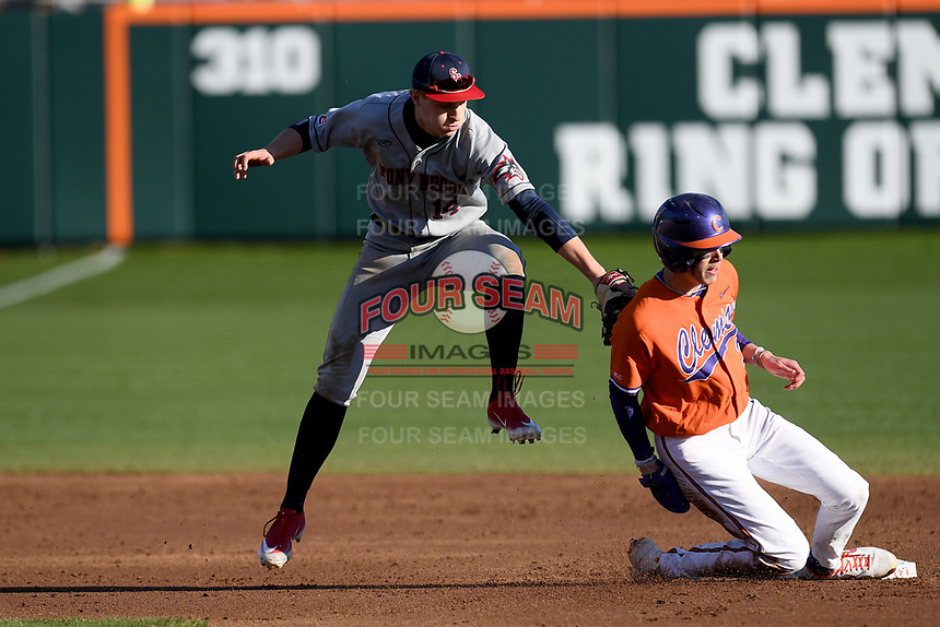First baseman Dylan Brewer (3) of the Clemson Tigers is safe at second in a game against the Stony Brook Seawolves on Friday, February 21, 2020, at Doug Kingsmore Stadium in Clemson, South Carolina. Brett Paulsen (14) of the Seawolves makes the tag. Clemson won, 2-0. (Tom Priddy/Four Seam Images)