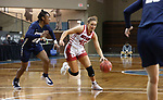 SIOUX FALLS, SD - MARCH 6: Maddie Krull #42 of the South Dakota Coyotes drives past Addisyn Moore #32 of the Oral Roberts Golden Eagles during the Summit League Basketball Tournament at the Sanford Pentagon in Sioux Falls, SD. (Photo by Richard Carlson/Inertia)