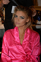 MIAMI, FL - JULY 18: Kelly Rohrbach prepares backstage at the Beach Bunny Featuring The Blonds show during Mercedes-Benz Fashion Week Swim 2015 at Cabana Grande at The Raleigh on July 18, 2014 in Miami, Florida. <br />