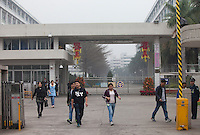 Workers leave the Yue Yuen Industrial Holdings Limited factory in Dongguan, Guangdong Province, China, 03 March 2015.
