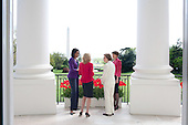 Washington, DC - April 21, 2009 -- First Lady Michelle Obama hosts former First Lady Rosalynn Carter, Dr. Jill Biden and Maria Eitel in the Blue Room of the White House in Washington, D.C. on Tuesday, April 21, 2009..Credit: Samantha Appleton - White House via CNP