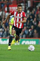 Ollie Watkins of Brentford dribbles with the ball during the Sky Bet Championship match between Brentford and Derby County at Griffin Park, London, England on 26 September 2017. Photo by Carlton Myrie / PRiME Media Images.