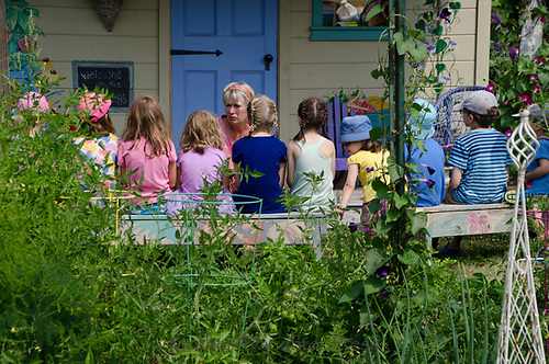 Kids in outdoor classroom with teacher, Maine, USA
