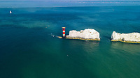 BNPS.co.uk (01202 558833)<br /> Pic: TWT/BNPS<br /> <br /> Pictured: Rob Wylie approaching the finish line near The Needles.<br /> <br /> A daredevil businessman has created a new record by being the first person to circumnavigate the Isle of Wight on an eFoil board.<br /> <br /> Rob Wylie, 51, completed the 55-mile circular route in just 2 hours, 46 minutes and 23 seconds on a Fliteboard, an electric-powered hydrofoil board.<br /> <br /> The board hovers about 3ft above the water and Rob travelled at an average speed of 20mph.