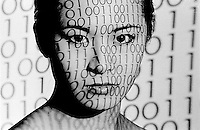 Asian woman with 1's and zeros projected on her face<br />