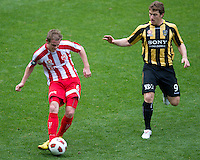 MELBOURNE, AUSTRALIA - SEPTEMBER 19, 2010: Matt Thompson from the Heart kicks the ball in Round 7 of the 2010 A-League between the Melbourne Heart and Wellington Phoenix at AAMI Park on September 19, 2010 in Melbourne, Australia. (Photo by Sydney Low / Asterisk Images)
