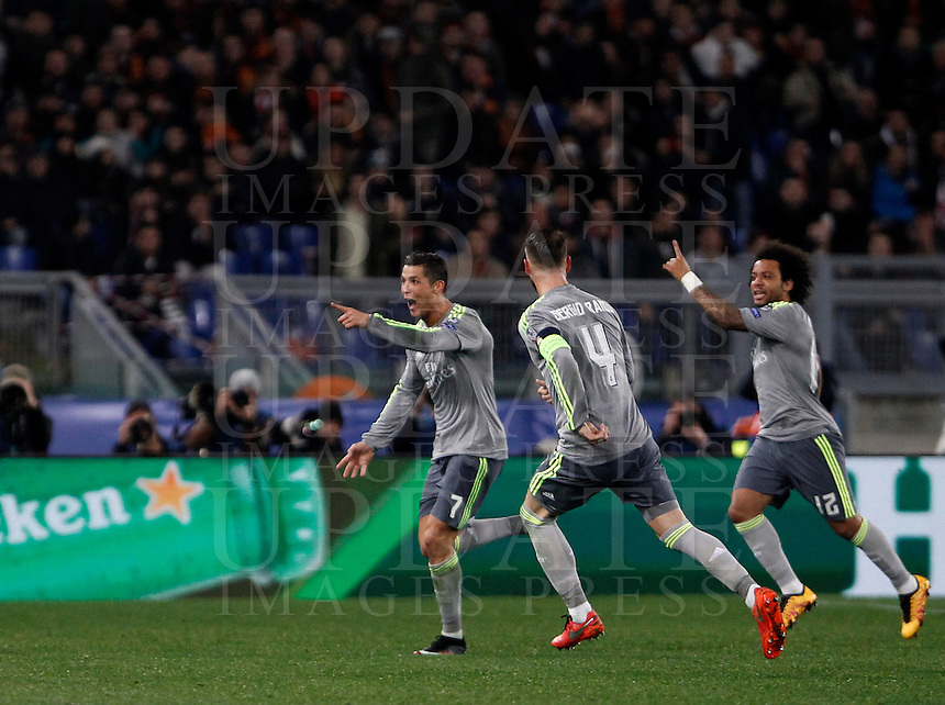 Calcio, andata degli ottavi di finale di Champions League: Roma vs Real Madrid. Roma, stadio Olimpico, 17 febbraio 2016.<br /> Real Madrid's Cristiano Ronaldo, left, celebrates with teammates Sergio Ramos, center, and Marcelo after scoring during the first leg round of 16 Champions League football match between Roma and Real Madrid, at Rome's Olympic stadium, 17 February 2016.<br /> UPDATE IMAGES PRESS/Isabella Bonotto