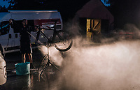 Team JLT-Condor mechanics cleaning the bikes late into the night after a long post-stage transfer to the team hotel<br /> <br /> 15th Ovo Energy Tour of Britain 2018