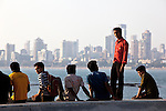 MUMBAI, INDIA - SEPTEMBER 27, 2010: People enjoy the late afternoon sunshine on Marine parade known as the Queens Necklace. After dark the sweeping roadway lights up like string of pearls framing the waterline of Mumbai.The Taj Mahal Palace and Tower Hotel has re-opened after the terror attacks of 2008 destroyed much of the heritage wing. The wing has been renovated and the hotel is once again the shining jewel of Mumbai. pic Graham Crouch