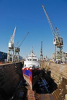 Ship being repaint in dry dock, Cape Town, South Africa