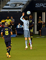 KANSAS CITY, KS - OCTOBER 11: #6 Ilie Sanchez of Sporting Kansas City tries to stop #27 Tah Brian Anunga of Nashville SC from heading the ball during a game between Nashville SC and Sporting Kansas City at Children's Mercy Park on October 11, 2020 in Kansas City, Kansas.