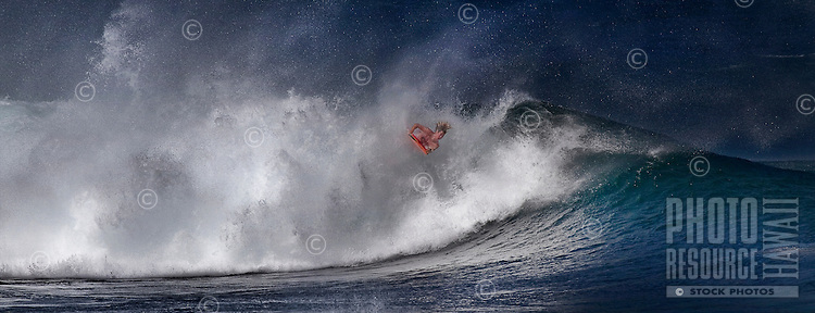 Bodyboarder trying his best on a tough wave at the Banzai Pipeline on North Shore of Oahu.